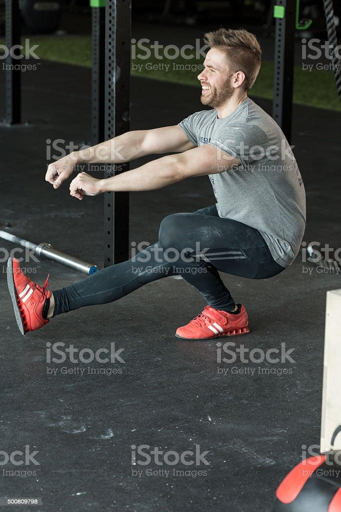 Man doing one leg squat stock photo