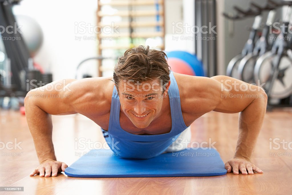 Man Doing Press Ups In Gym royalty-free stock photo