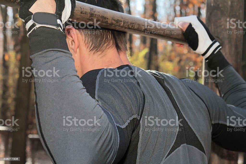 Man Doing Pull Ups Chin-Ups. stock photo