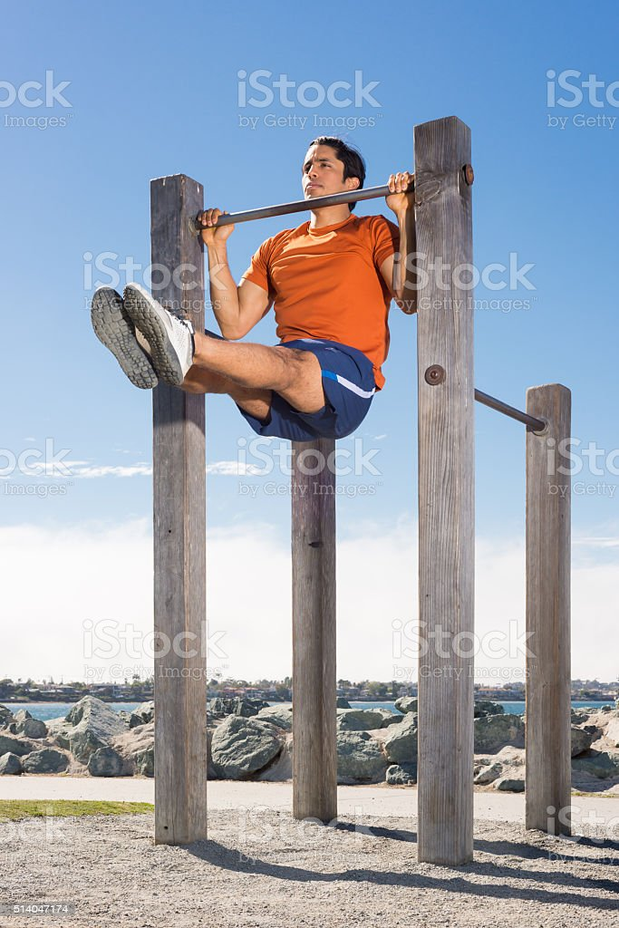 Man Doing Pull Ups Outdoors stock photo