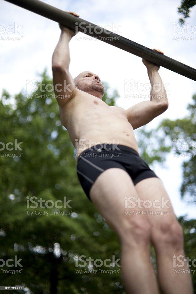 man doing pull-ups royalty-free stock photo