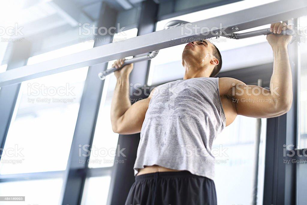 Man doing pullups. stock photo