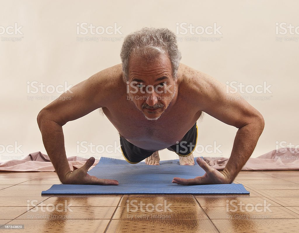 Man doing push ups at gym royalty-free stock photo