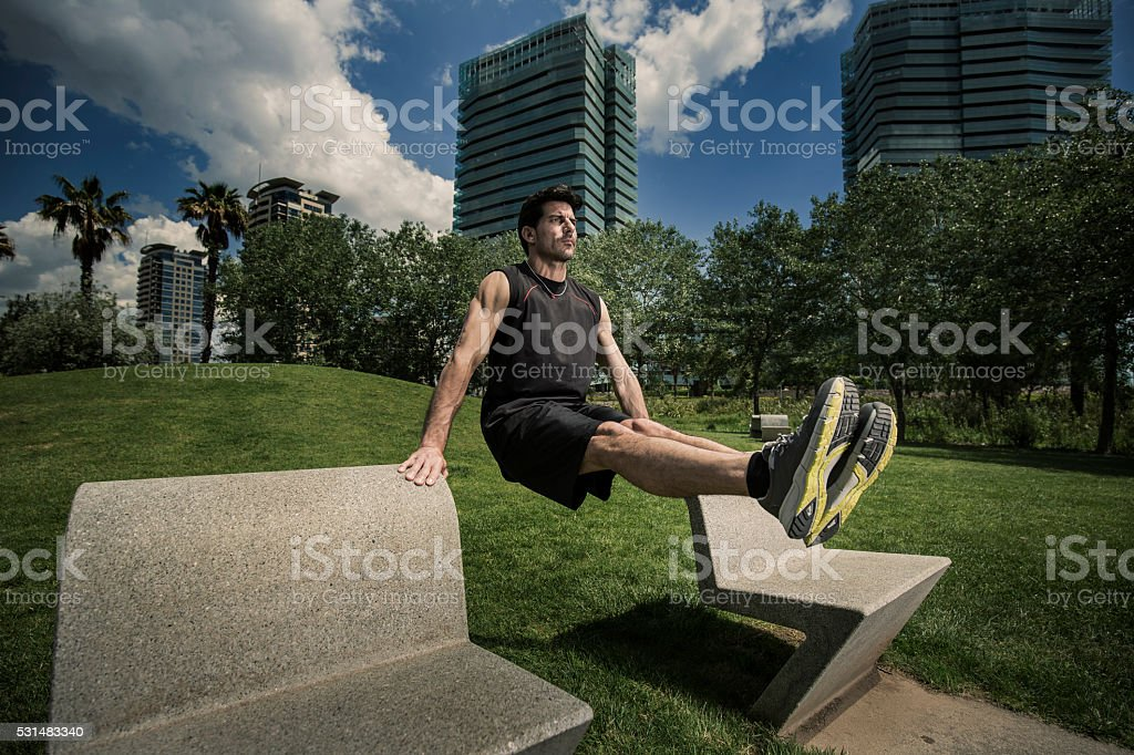 Man doing push ups in the city stock photo