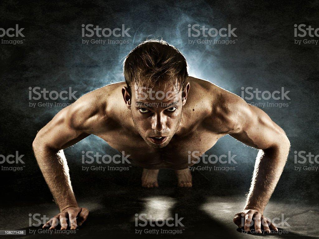 Man doing push ups royalty-free stock photo