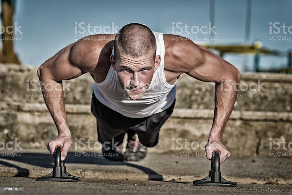 Man doing push-ups stock photo