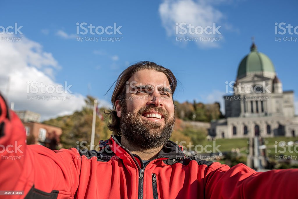 Man Doing Selfie in Front of Saint Joseph's Oratory, Montreal stock photo