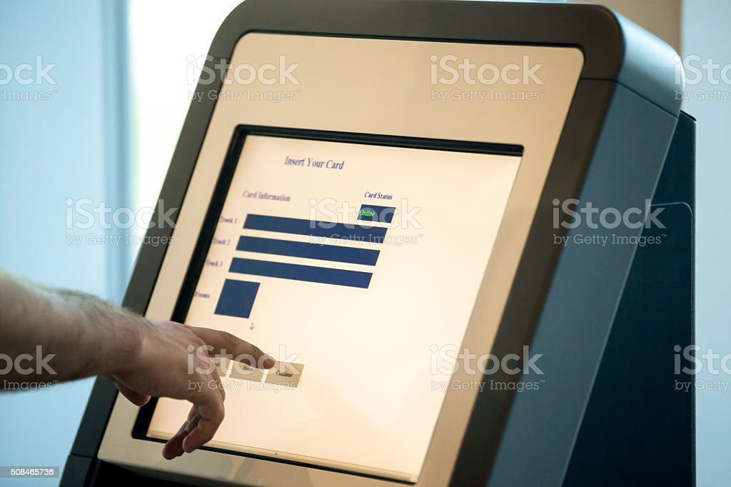 Man doing self-registration for flight, close up stock photo