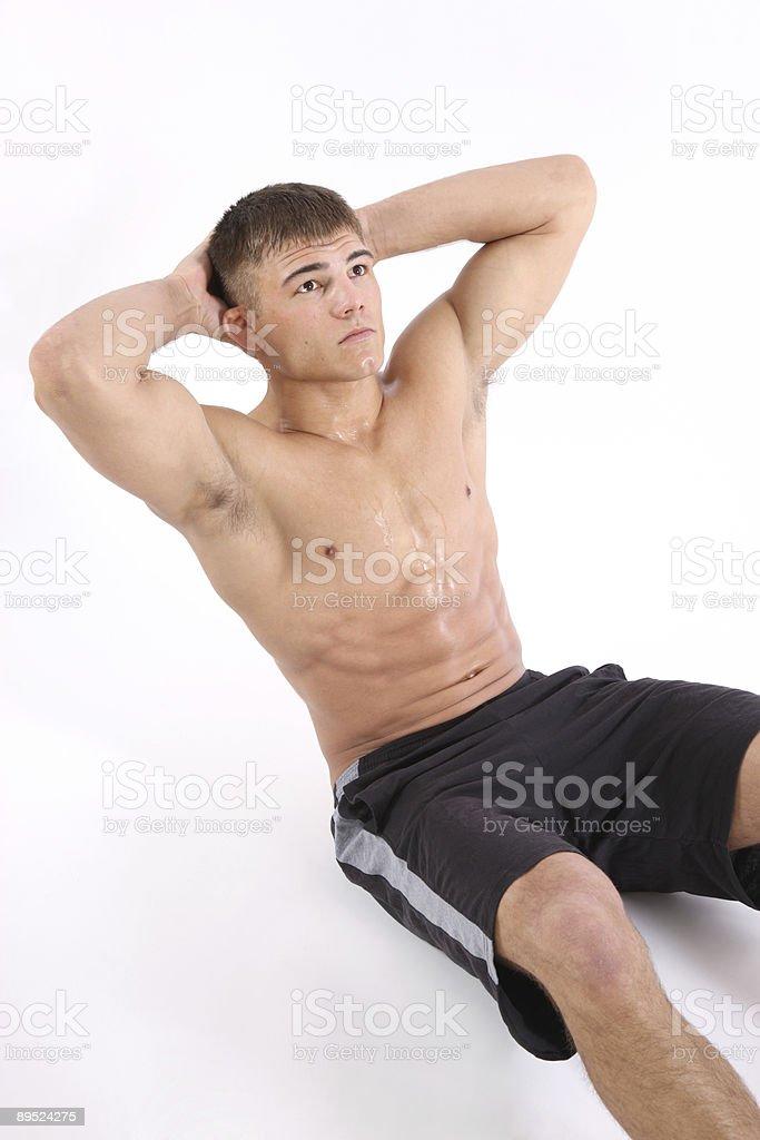 Man doing sit-ups royalty-free stock photo