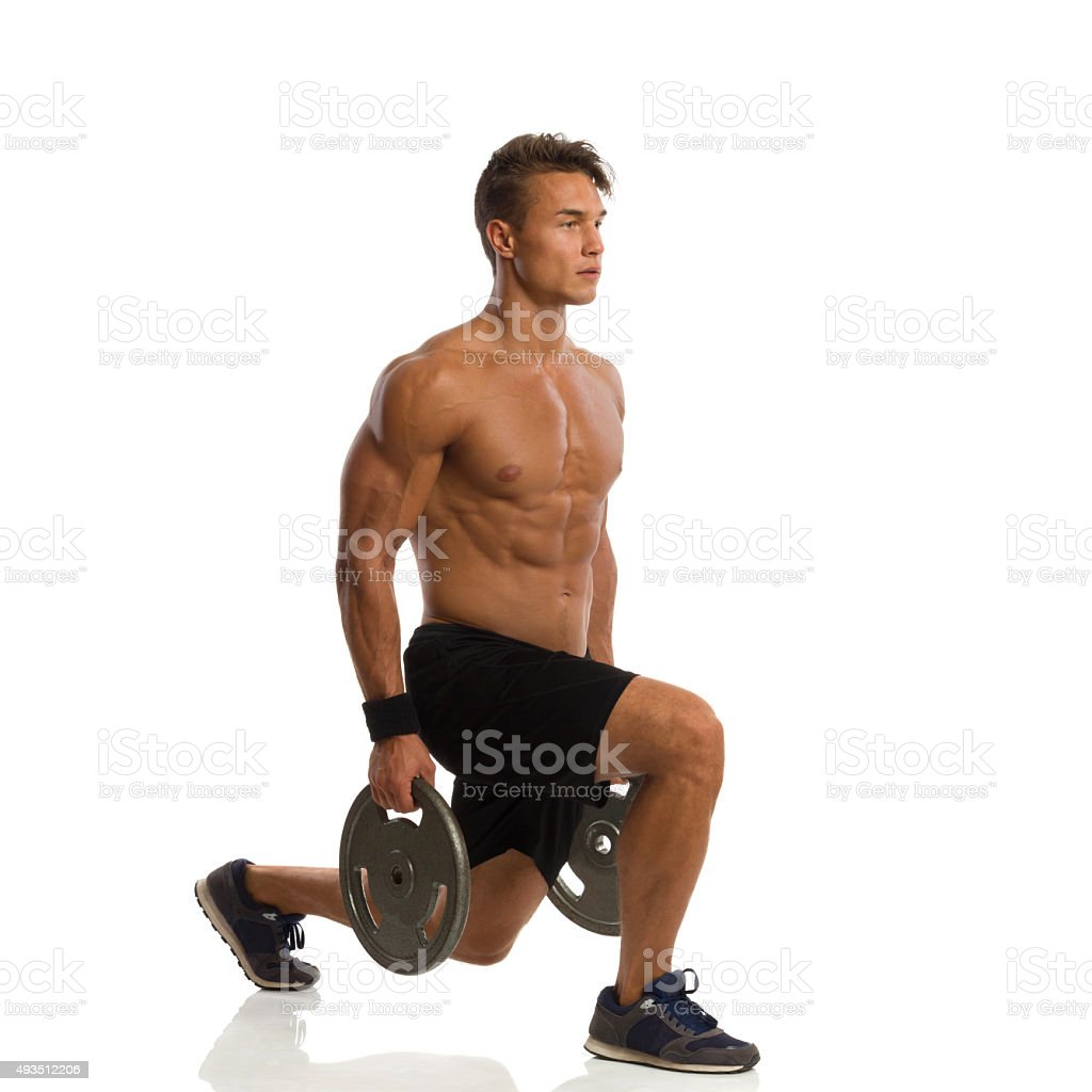 Man Doing Split Squat With Weights. Side View stock photo