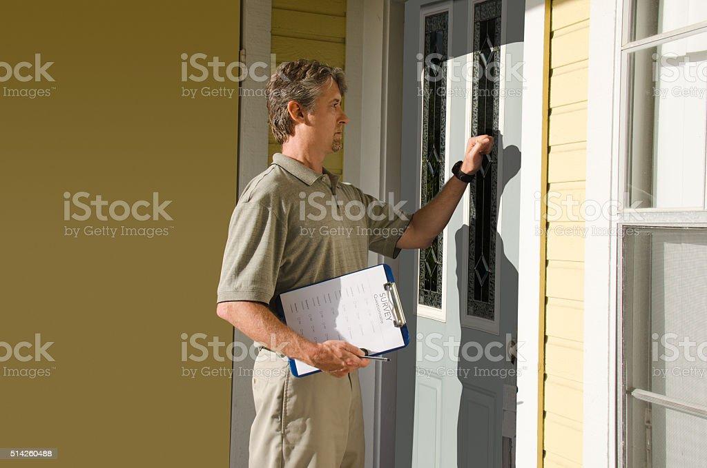 Man doing survey or petition work door-to-door stock photo