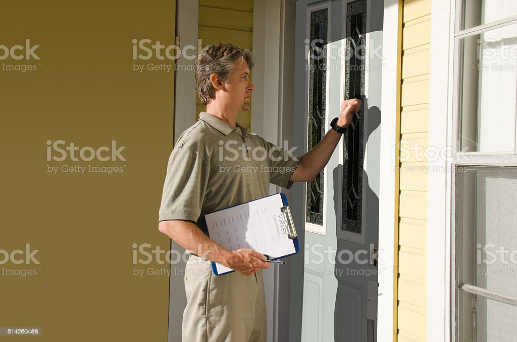 Man doing survey or petition work door-to-door stock photo