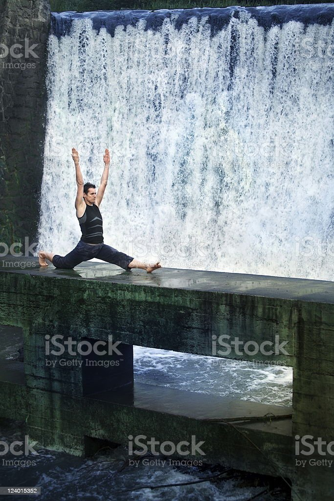 Man doing the splits in nature stock photo