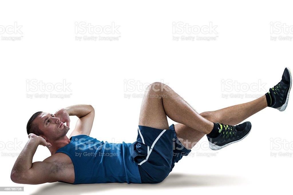 Man doing tummy crunches stock photo