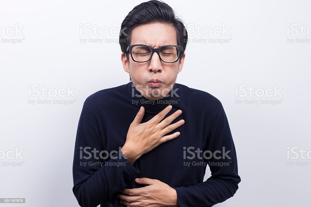 Man doing vomiting gesture stock photo