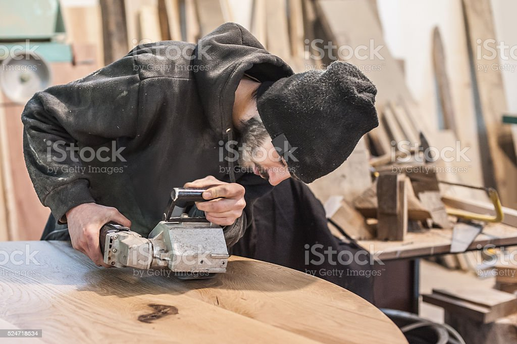 Man doing woodwork in carpentry stock photo
