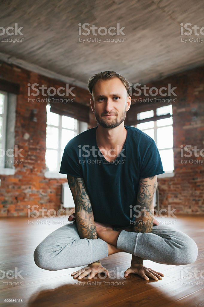 Man doing yoga in studio stock photo