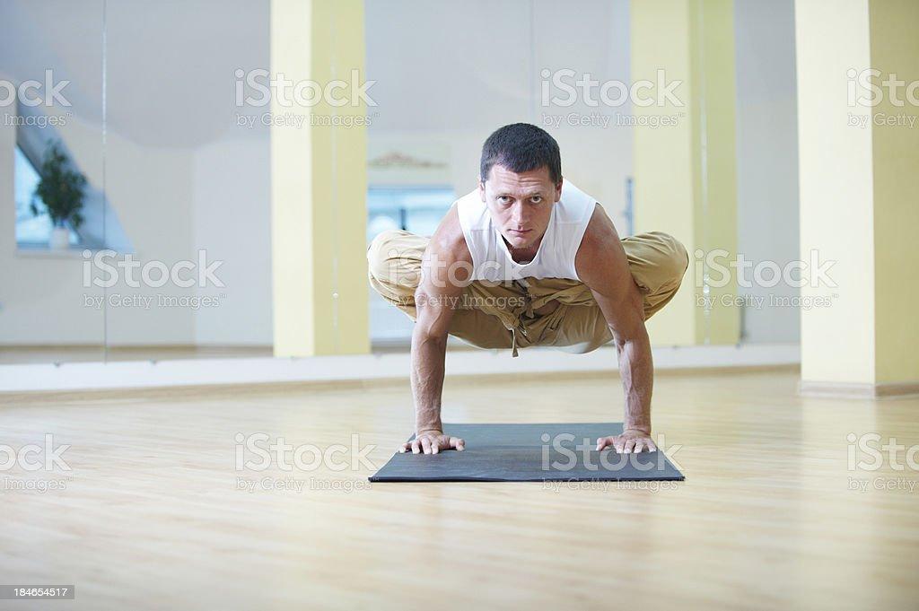 man doing yoga stock photo
