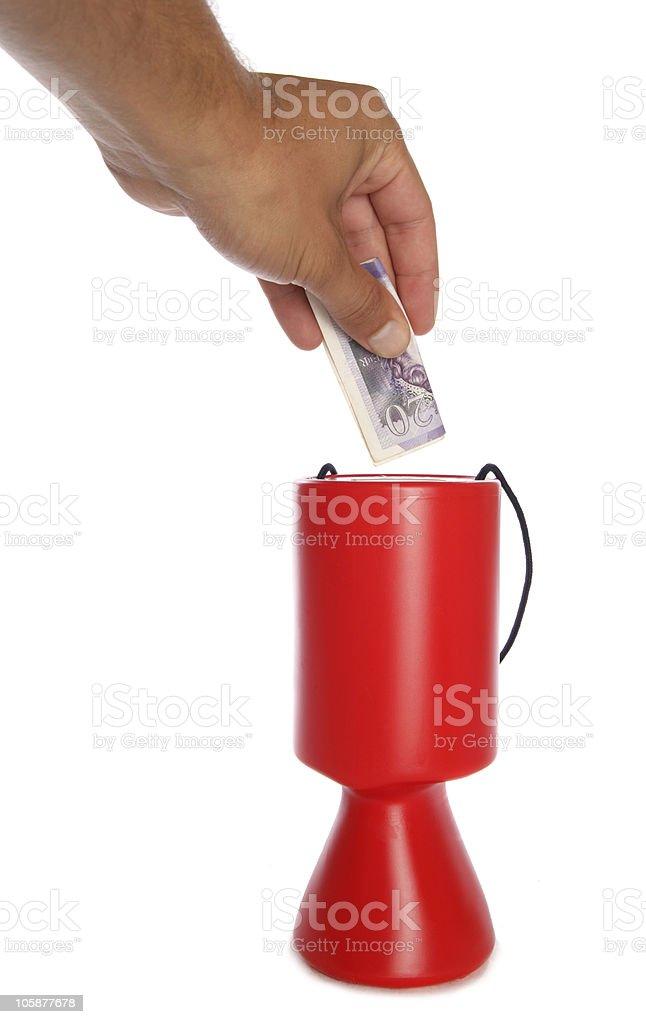 Man donating twenty pounds to charity royalty-free stock photo