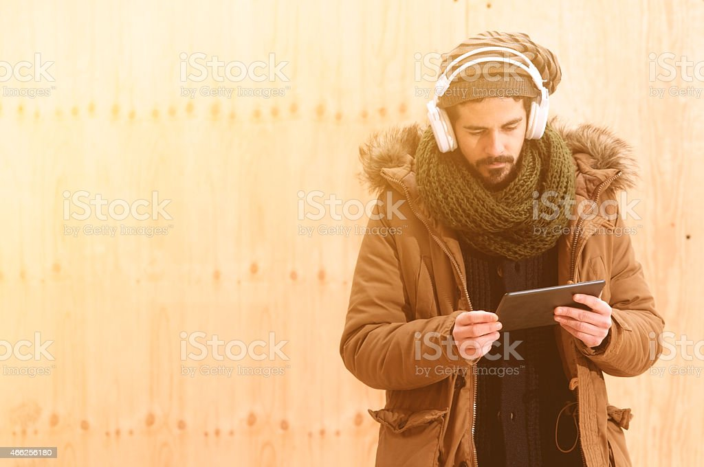Man downloading music in instagram style stock photo