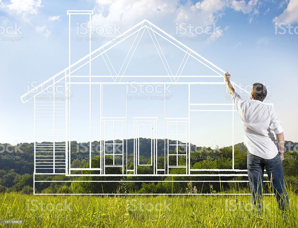 Man drawing a blue print of house in nature stock photo
