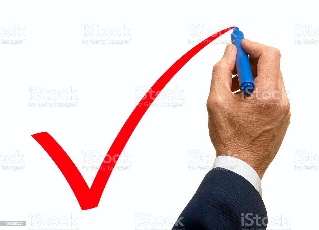 Man drawing a check mark on white board royalty-free stock photo