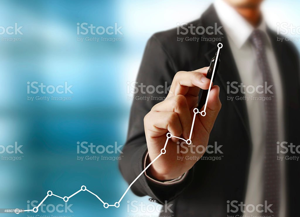 Man drawing a growing graph stock photo