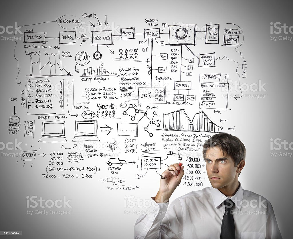 Man drawing a project diagram with a black market royalty-free stock photo