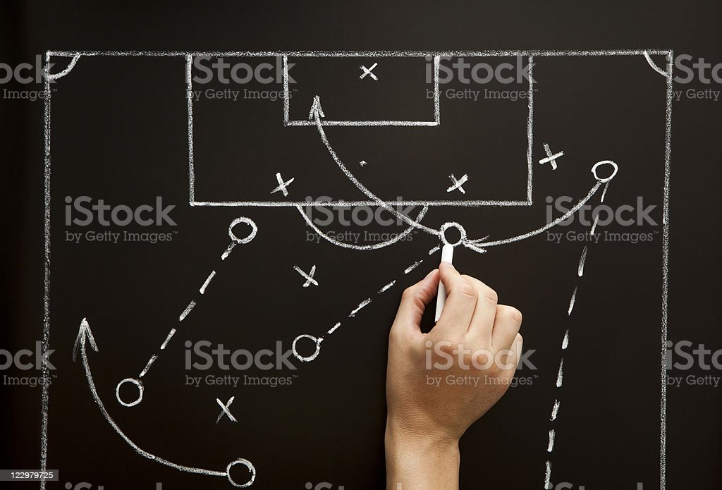 Man drawing a soccer game strategy stock photo