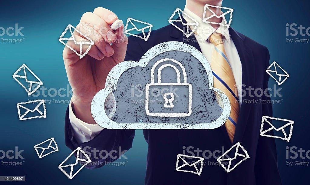 Man drawing an image representing secured cloud computing  royalty-free stock photo