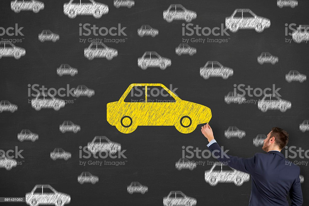 Man drawing car with chalk stock photo
