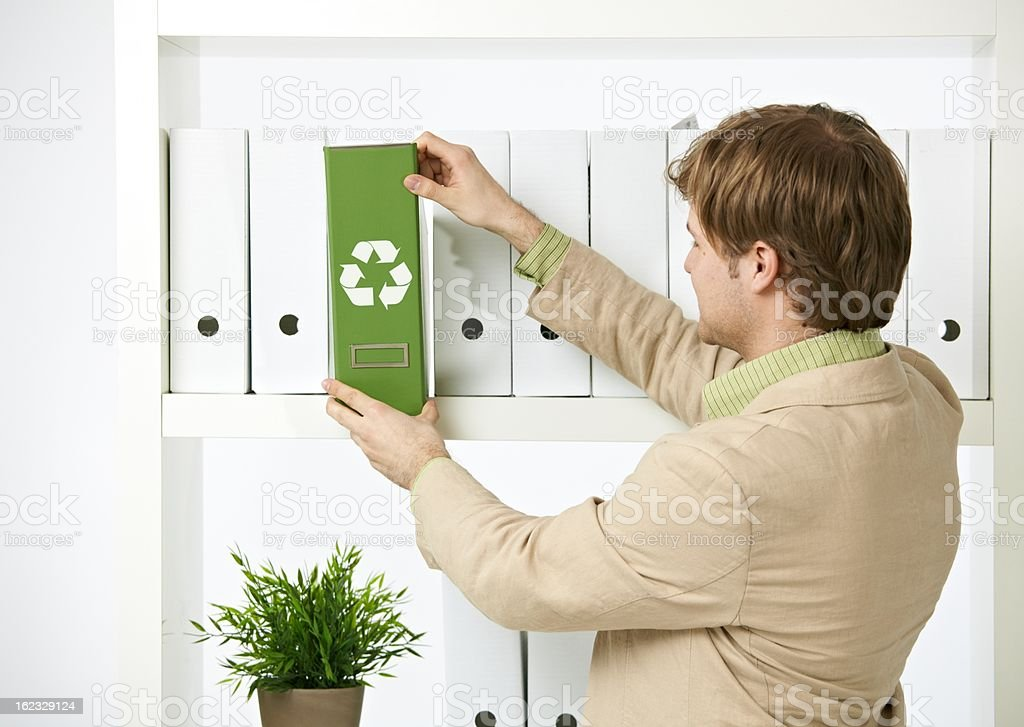 Man drawing out green folder royalty-free stock photo