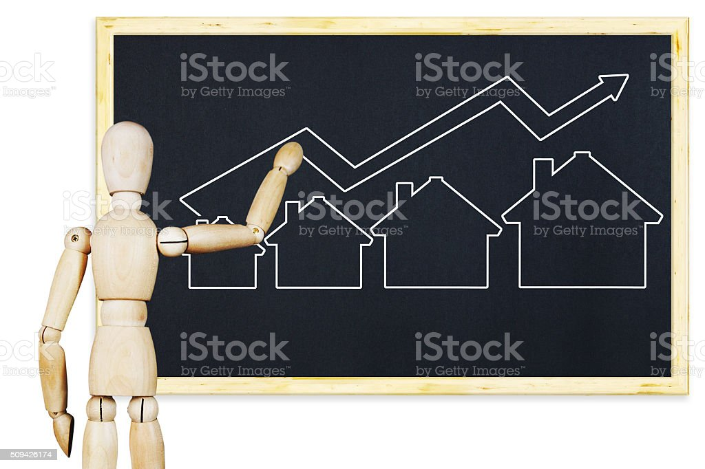 Man draws a graph of real estate sales growth stock photo