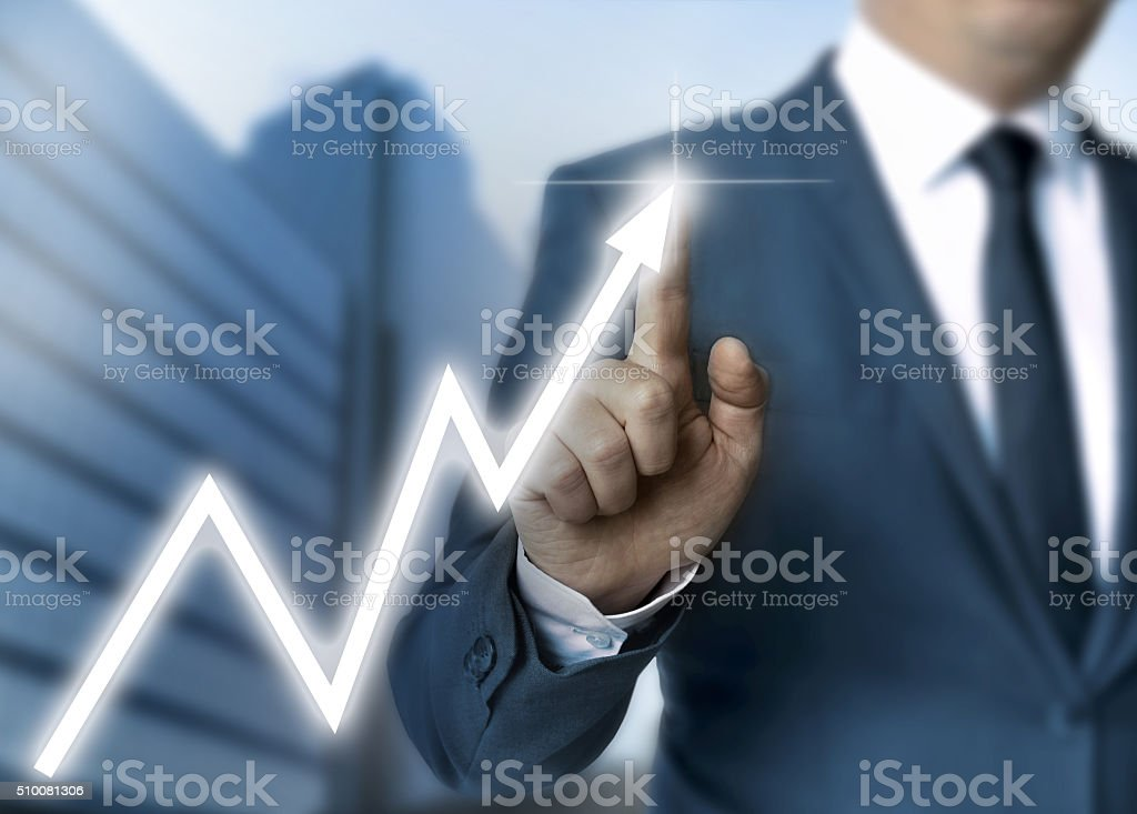 Man draws stock price touchscreen concept stock photo
