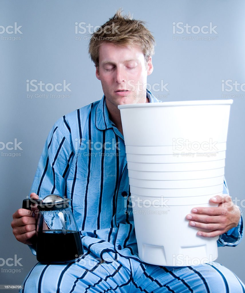 Man dreams about coffee and holds a gigant cup royalty-free stock photo
