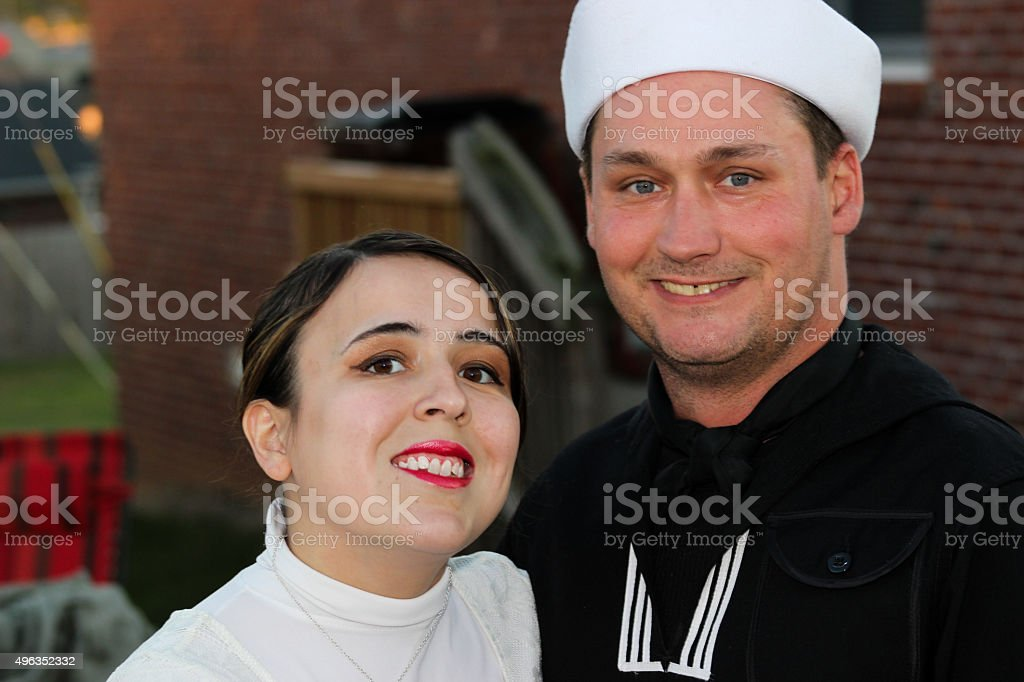 Man Dressed as Sailor Poses With Smiling Woman stock photo