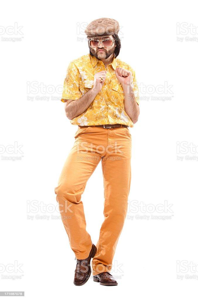 Man dressed in 70's style Hawaiian shirt disco dancing stock photo