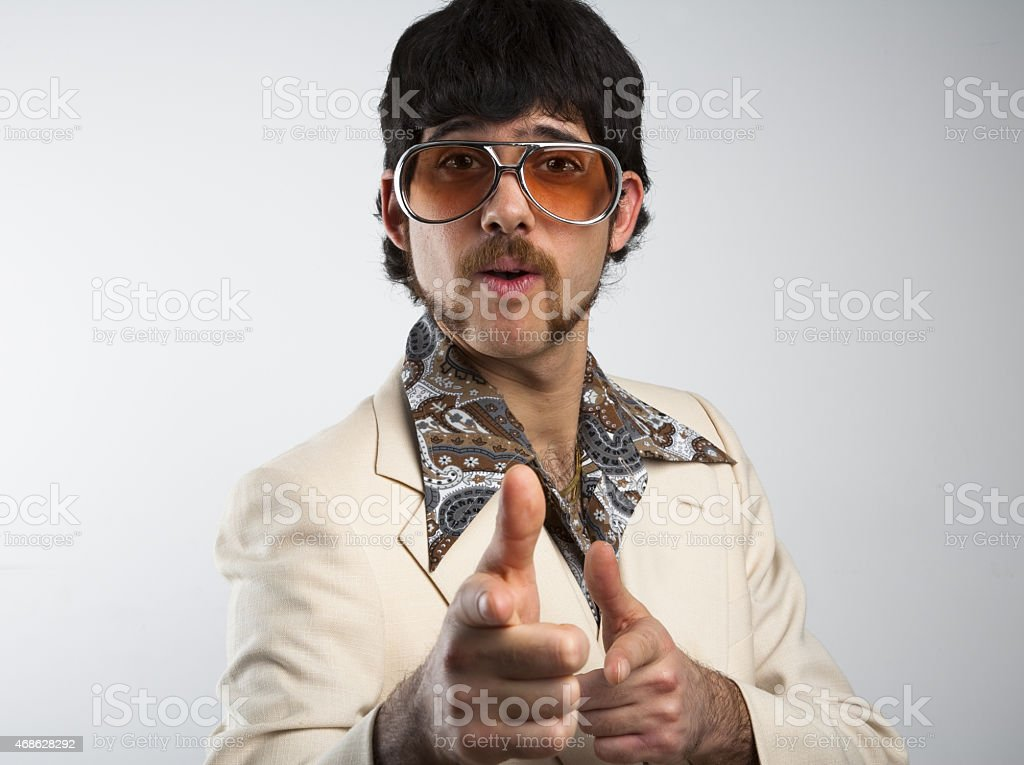A man dressed in clothes from the '70s on a white background stock photo