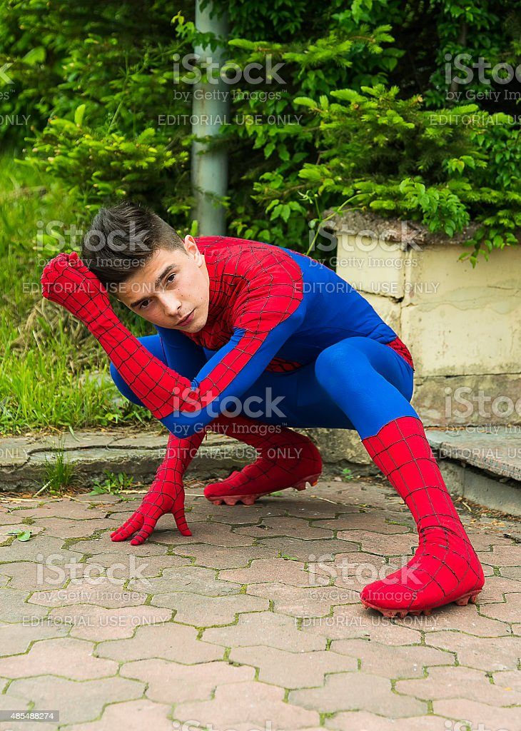Man  dressed in the costume spiderman stock photo