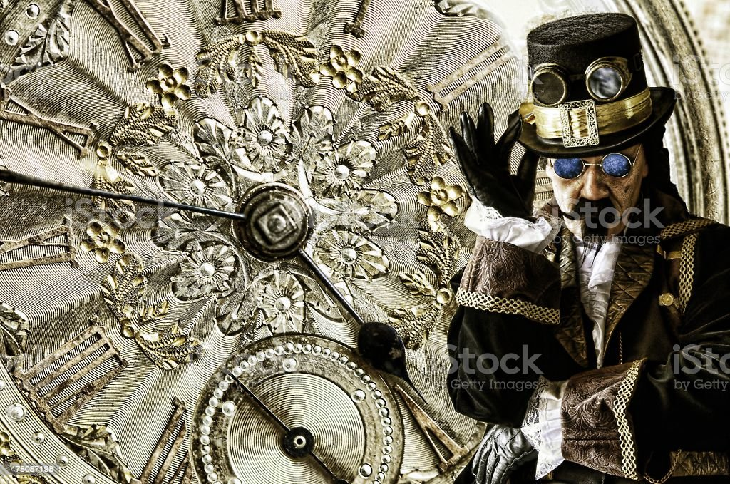 man dressed in vintage steampunk clothing with gold watch background stock photo