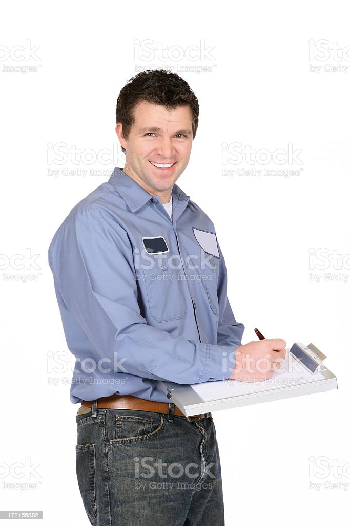 A man dressed in work clothing providing service to someone royalty-free stock photo