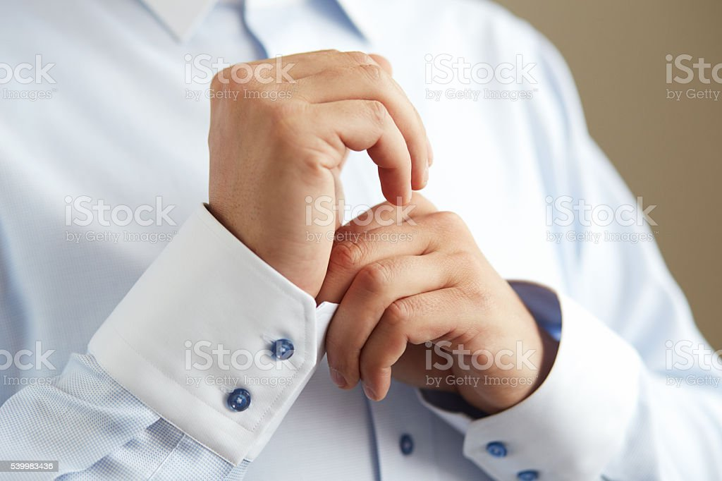 Man dresses for wedding to shirt stock photo