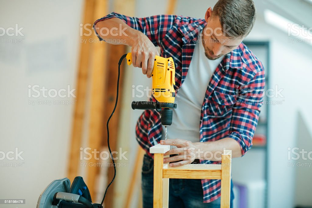 Man Drilling a plank. stock photo