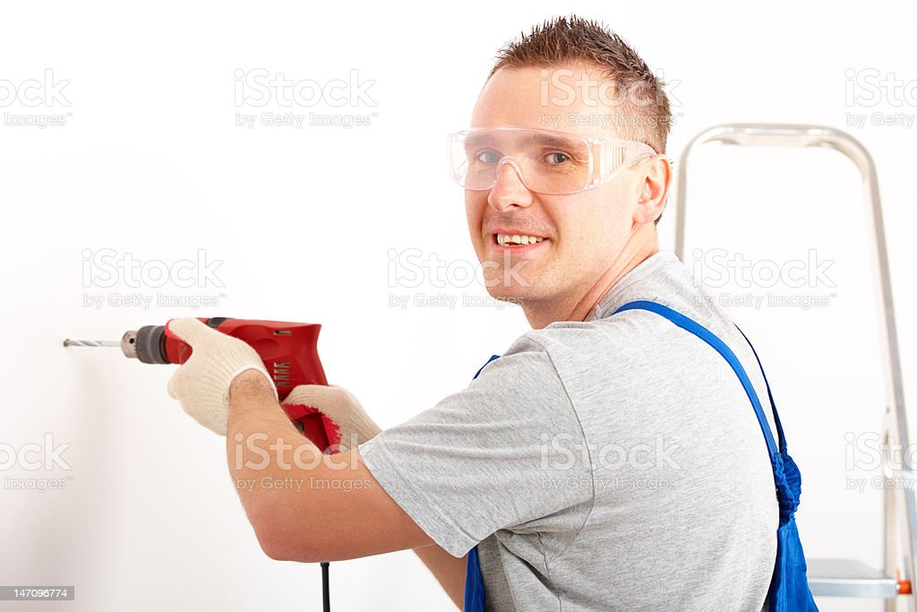 Man drilling hole royalty-free stock photo