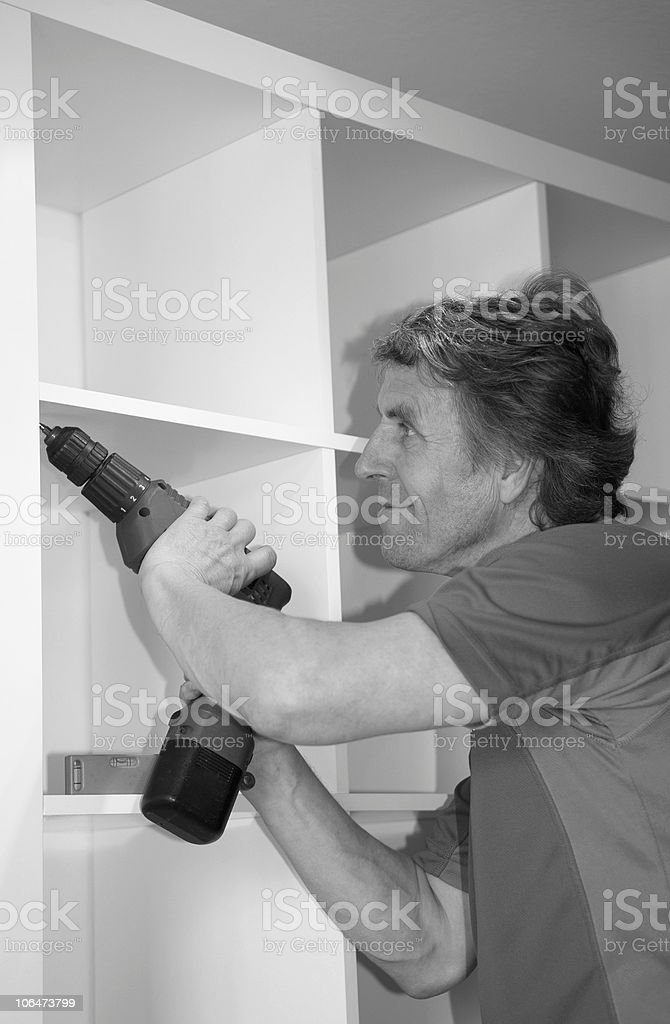 Man Drilling Holes royalty-free stock photo
