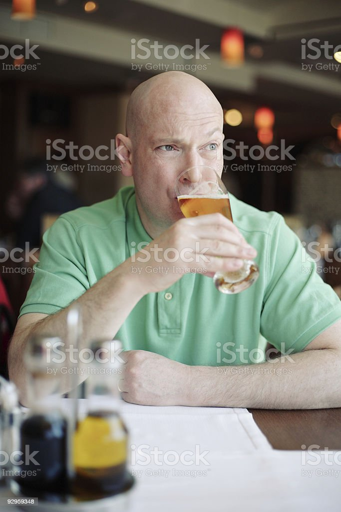 Man Drinking Beer in restaurant royalty-free stock photo