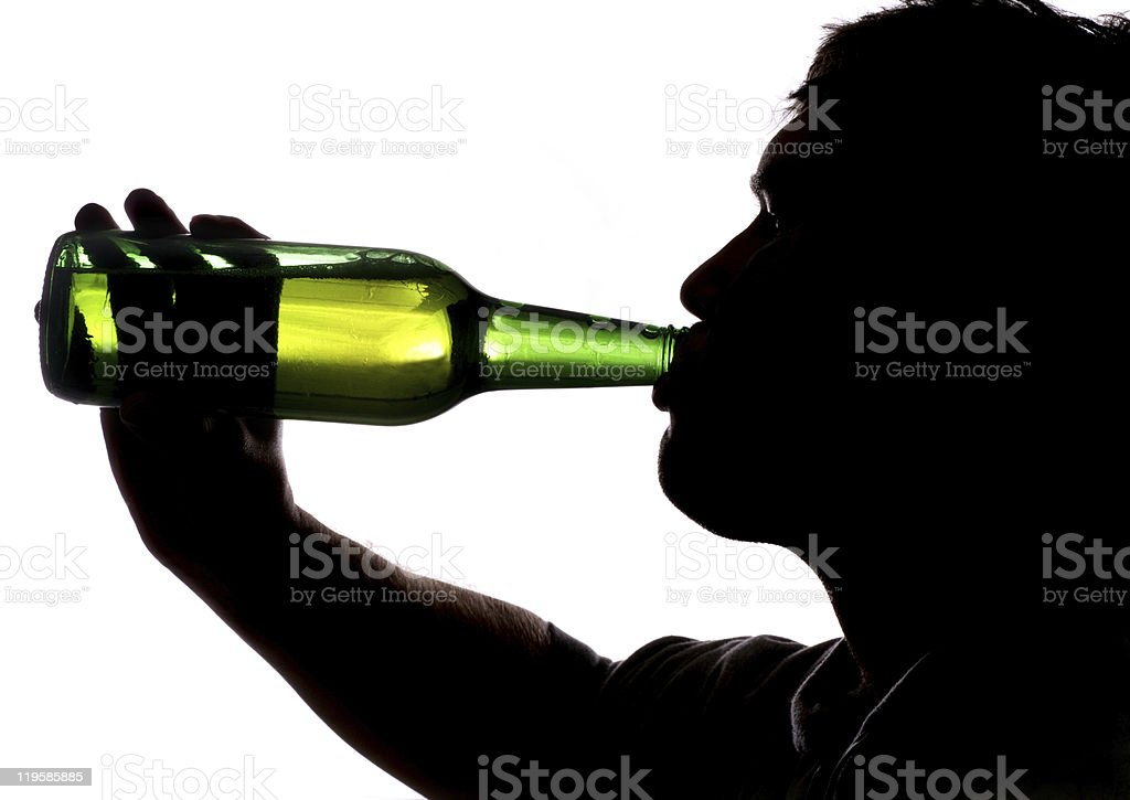 Man drinking bottle of beer royalty-free stock photo