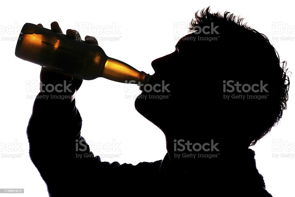 Man drinking bottle of cider stock photo