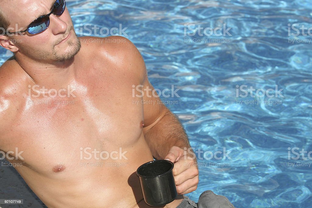 Man drinking coffee by the pool royalty-free stock photo