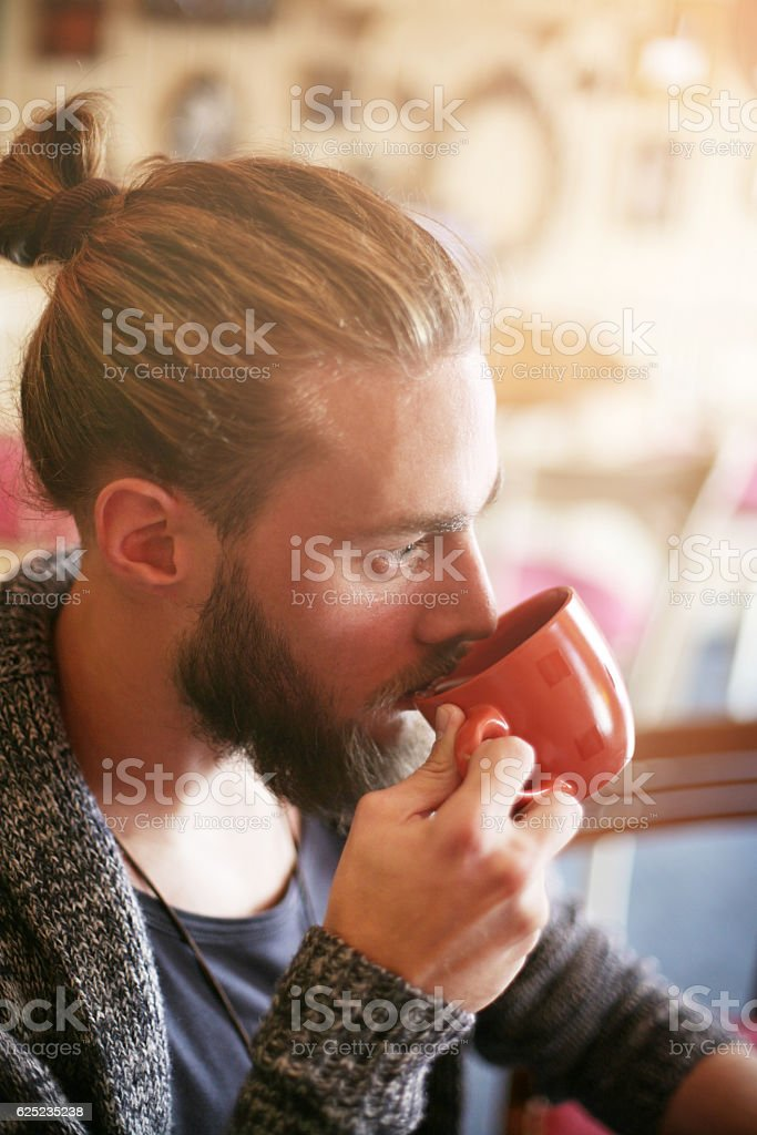 Man drinking coffee in cafe. stock photo